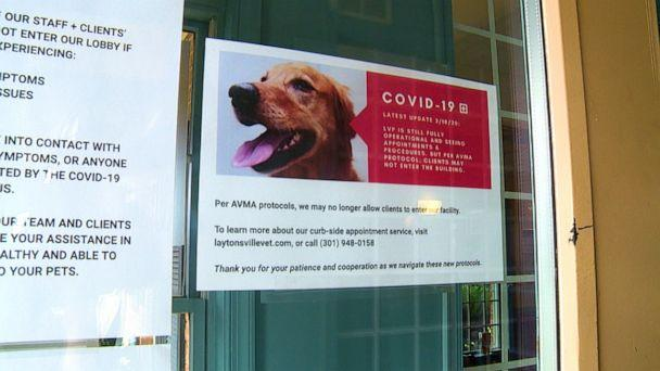 PHOTO: Signs posted at the door to the Laytonsville Veterinary Practice in Maryland inform pet owners of new protocols currently being utilized at the clinic amid the COVID-19 pandemic. (Becky Perlow/ABC News)