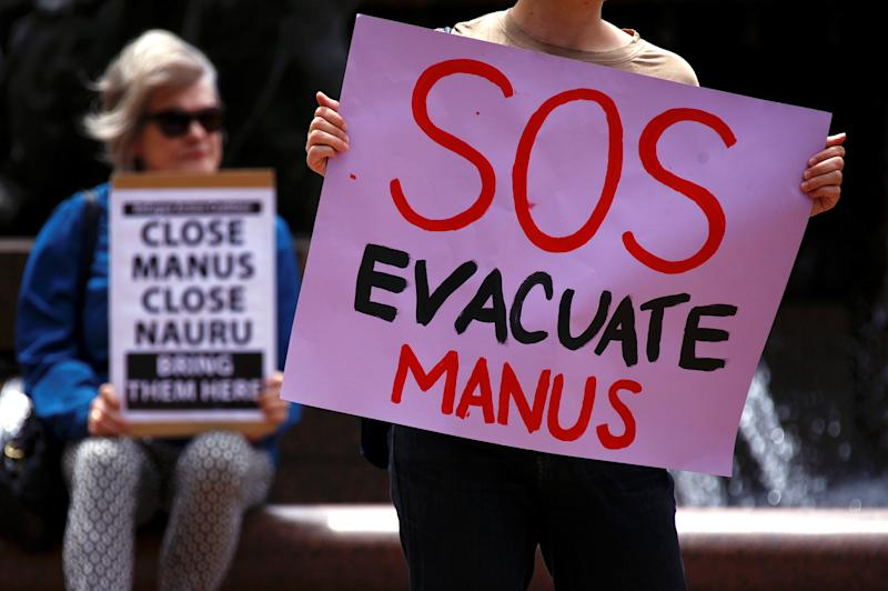 Authorities were attempting to remove hundreds of asylum seekers from a detention center in Papua New Guinea on Thursday after the Australian government closed the facility last month. (David Gray / Reuters)