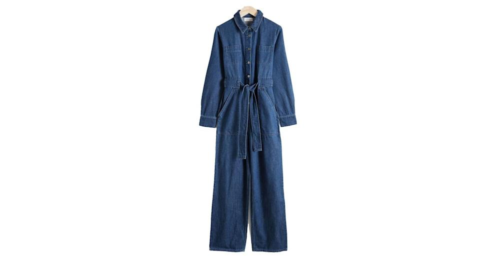 """<p>Any outfit that can be worn to paint the house and attend fashion week at the turn of a dime is ok with us. <br><a rel=""""nofollow noopener"""" href=""""https://www.stories.com/en_gbp/whats-new/all/product.denim-overall-jumpsuit-blue-dark.0598378001.html"""" target=""""_blank"""" data-ylk=""""slk:Buy here."""" class=""""link rapid-noclick-resp"""">Buy here.</a> </p>"""