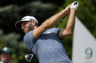 Dustin Johnson watches his shot off the ninth tee in the first round of play at the Northern Trust golf tournament, Thursday, Aug. 19, 2021, at Liberty National Golf Course in Jersey City, N.J. (AP Photo/John Minchillo)