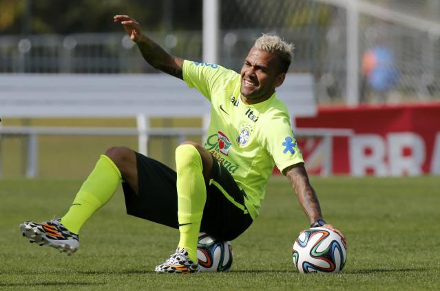 Brazil's Daniel Alves attends a training session in Teresopolis near Rio de Janeiro July 7, 2014. Brazil will meet Germany in their 2014 World Cup semi-finals on July 8. REUTERS/Marcelo Regua (BRAZIL - Tags: SOCCER SPORT WORLD CUP)
