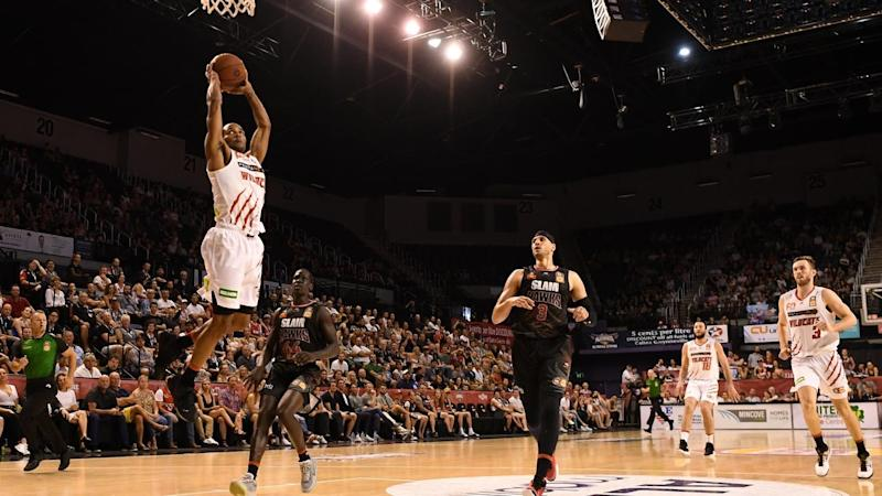 Bryce Cotton soars for a breakaway dunk in Perth's 22-point win over Illawarra on Friday