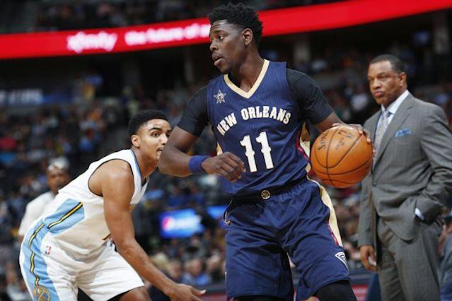 Jrue Holiday averaged 15.4 points and 7.3 assists this past season. (AP)