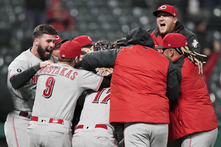 Cincinnati Reds teammates mob starting pitcher Wade Miley after he pitched a no-hitter in a baseball game against the Cleveland Indians, Friday, May 7, 2021, in Cleveland. (AP Photo/Tony Dejak)