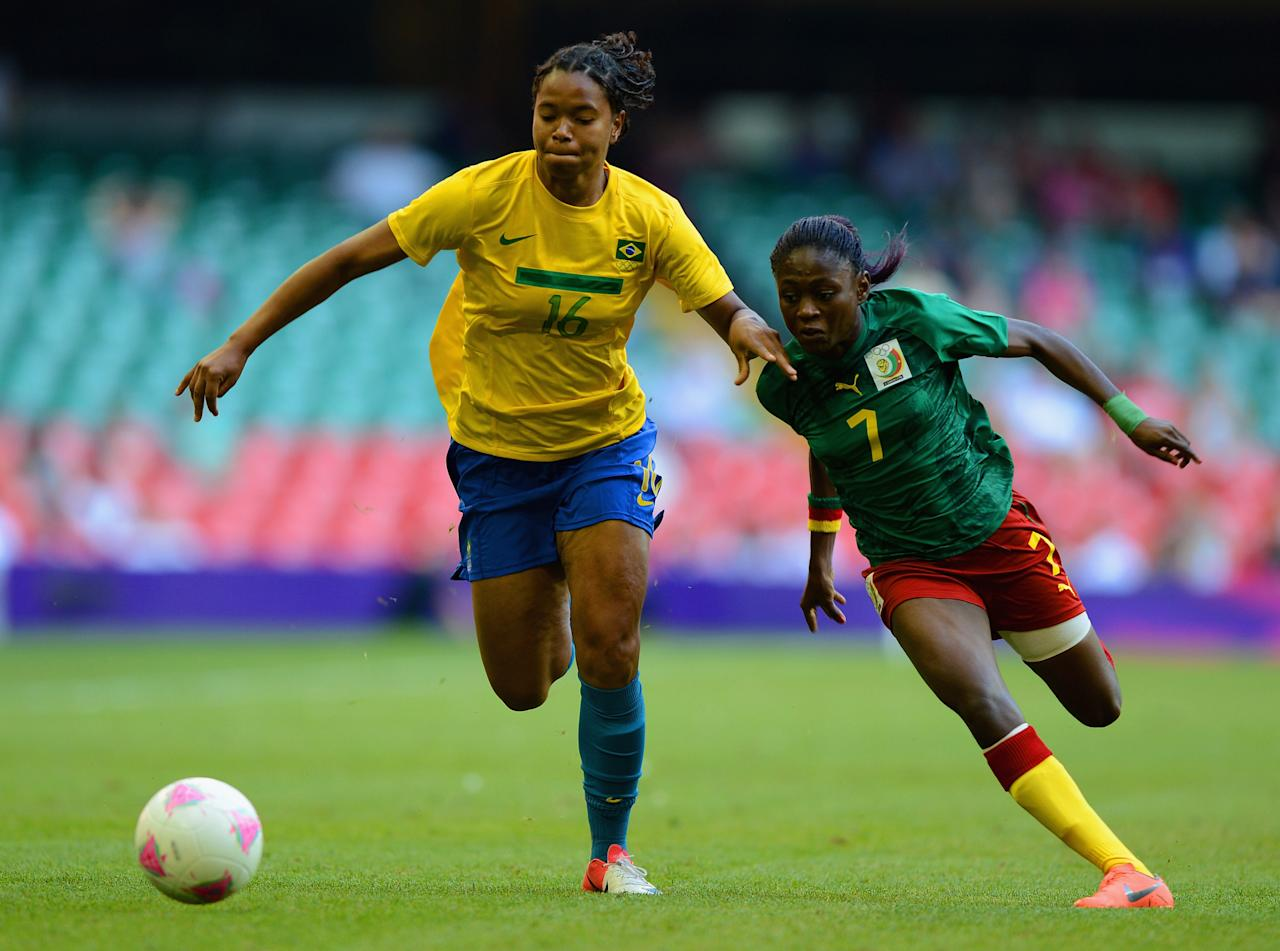 CARDIFF, WALES - JULY 25:  Renata Costa of Brazil battles with Gabrielle Onguene of Cameroon during the First Round Women's Football Group E Match of the London 2012 Olympic Games between Cameroon and Brazil at Millennium Stadium on July 25, 2012 in Cardiff, Wales.  (Photo by Michael Regan/Getty Images)