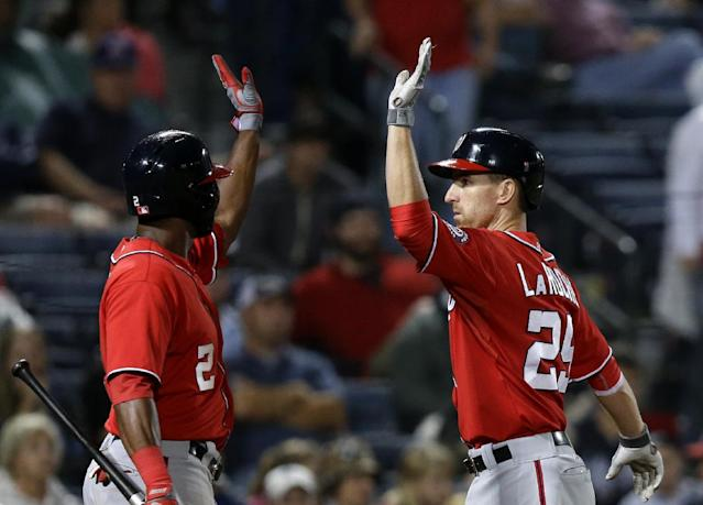 Washington Nationals' Adam LaRoche, right, is high-fived by teammate Denard Span after hitting a home run in the 15th inning of a baseball game against the Atlanta Braves, Sunday, Aug. 18, 2013, in Atlanta. (AP Photo/David Goldman)
