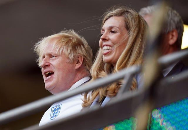 Prime Minister Boris Johnson and Carrie Johnson in the stands during the Euro 2020 semi-final at Wembley Stadium