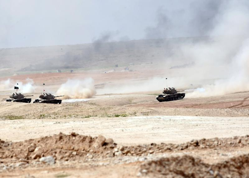 Tanks drive during the Northern Thunder military exercises in Hafr al-Batin, on March 10, 2016