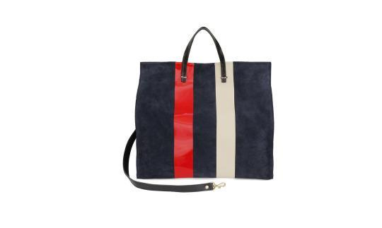 """<p>Simple Tote in Marine Suede with Gloss Red & Matte Cream Stripes, $495, <a href=""""https://www.clarev.com/collections/totes/products/simple-tote-marine-suede-glossy-red-matte-cream-stripes"""" rel=""""nofollow noopener"""" target=""""_blank"""" data-ylk=""""slk:clarev.com"""" class=""""link rapid-noclick-resp"""">clarev.com</a></p>"""