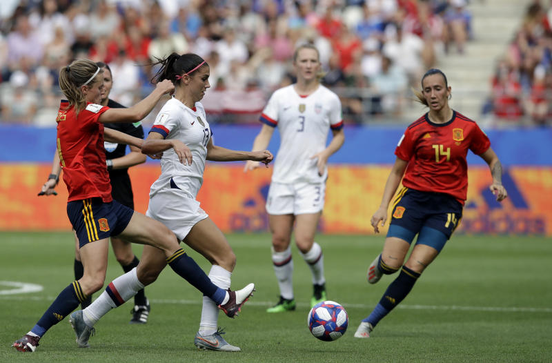 United States'Alex Morgan, right, is challenged by Spain's Irene Paredes, left, challenges during the Women's World Cup round of 16 soccer match between Spain and US at the Stade Auguste-Delaune in Reims, France, Monday, June 24, 2019. (AP Photo/Alessandra Tarantino)