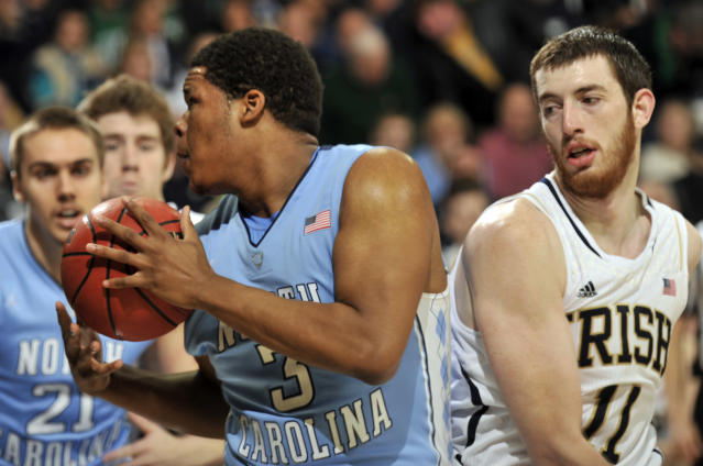 Nortrh Carolina forward Kennedy Meeks, left, grabs a rebound as Notre Dame forward Garrick Sherman defends during the first half of an NCAA college basketball game Saturday, Feb. 8, 2014, in South Bend, Ind. (AP Photo/Joe Raymond)