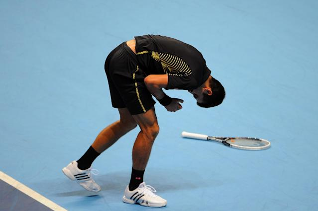LONDON, ENGLAND - NOVEMBER 12: Novak Djokovic of Serbia holds his arm after landing diving for a shot and landing on it during his men's singles final match against Roger Federer of Switzerland during day eight of the ATP World Tour Finals at O2 Arena on November 12, 2012 in London, England. (Photo by Michael Regan/Getty Images)