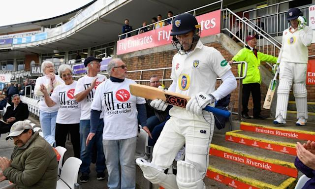 """<span class=""""element-image__caption"""">The Durham openers Stephen Cook, left, and Keaton Jennings walk out to bat next to fans in 'It's not cricket' T-shirts.</span> <span class=""""element-image__credit"""">Photograph: Stu Forster/Getty Images</span>"""