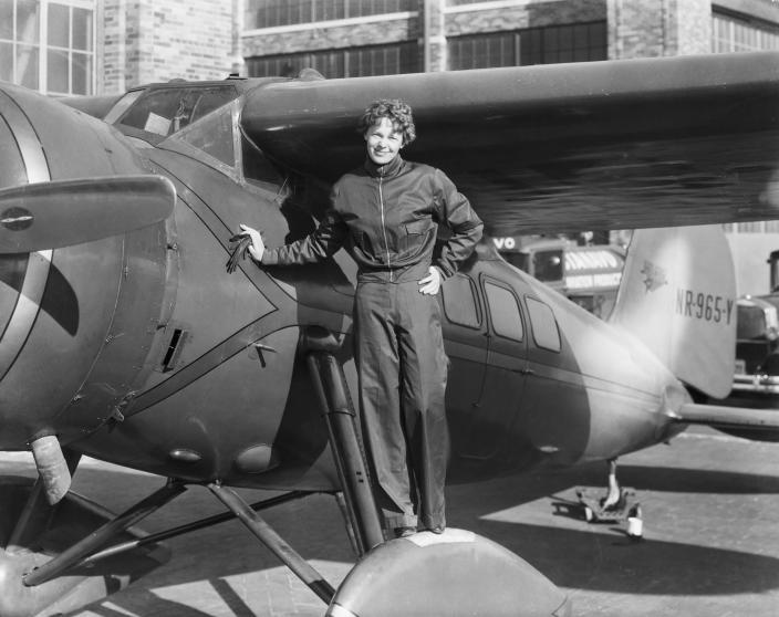 Amelia Earhart with her with airplane, circa 1935. (Getty Images)