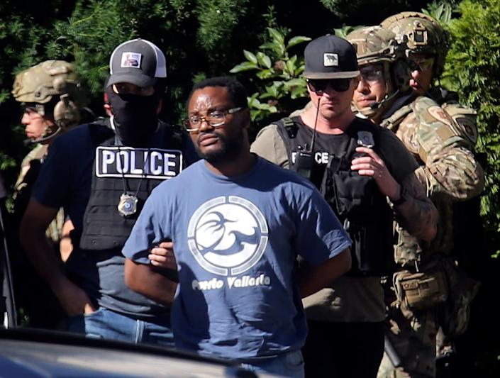 """<div class=""""inline-image__caption""""> <p>Salt Lake City police take Ayoola A. Ajayi into custody in connection with missing University of Utah student MacKenzie Lueck in Salt Lake City on Friday, June 28, 2019.</p> </div> <div class=""""inline-image__credit"""">Kristin Murphy/The Deseret News via AP</div>"""