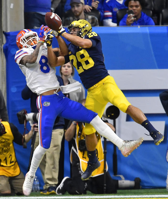 Michigan defensive back Brandon Watson (28) breaks up a pass in the end zone intended for Florida wide receiver Trevon Grimes (8) during the first half of the Peach Bowl NCAA college football game, Saturday, Dec. 29, 2018, in Atlanta. (AP Photo/Mike Stewart)