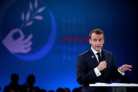 French President Emmanuel Macron delivers a speech at the opening session of the Paris Peace Forum