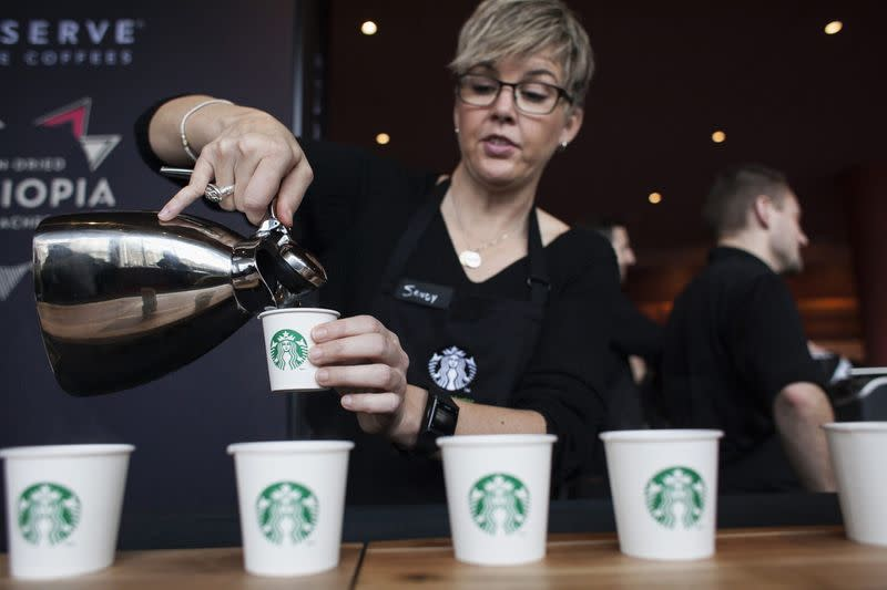 Barista Sandy Roberts pours samples of Starbucks coffee during the company's annual shareholders meeting in Seattle