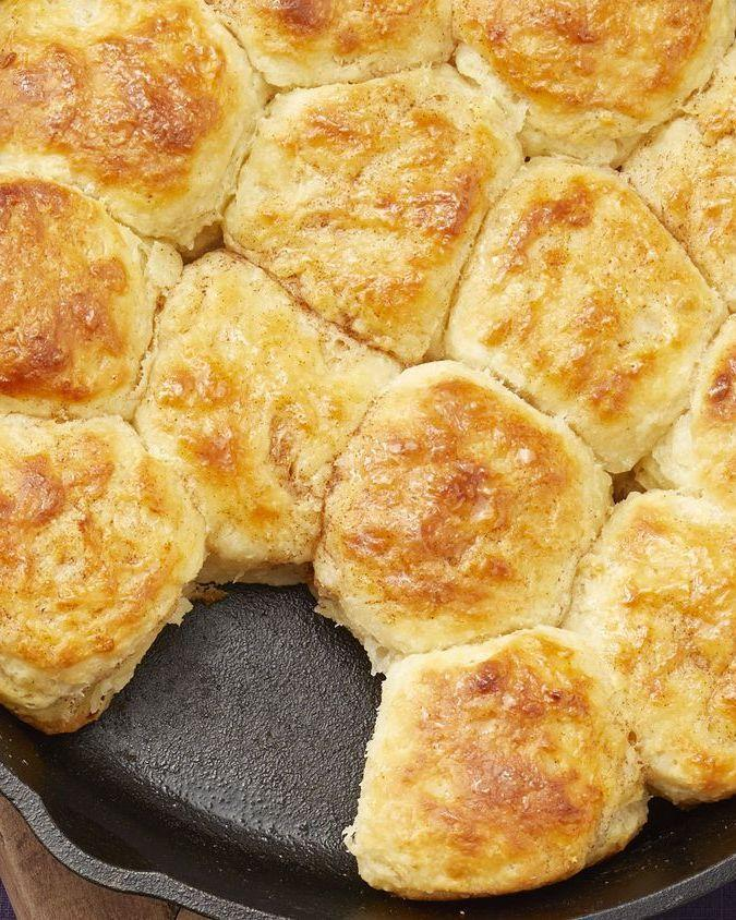 """<p>Yes, this cast-iron skillet looks beautiful. But it's also just plain practical: You can bake <em>and</em> serve the biscuits right inside of it.</p><p><strong><a href=""""https://www.thepioneerwoman.com/food-cooking/recipes/a34776142/skillet-biscuits-with-cinnamon-honey-butter/"""" rel=""""nofollow noopener"""" target=""""_blank"""" data-ylk=""""slk:Get the recipe"""" class=""""link rapid-noclick-resp"""">Get the recipe</a>.</strong></p><p><a class=""""link rapid-noclick-resp"""" href=""""https://go.redirectingat.com?id=74968X1596630&url=https%3A%2F%2Fwww.walmart.com%2Fip%2FThe-Pioneer-Woman-Timeless-Beauty-Cast-Iron-Set-3-Piece%2F55468725&sref=https%3A%2F%2Fwww.thepioneerwoman.com%2Ffood-cooking%2Fmeals-menus%2Fg35589850%2Fmothers-day-dinner-ideas%2F"""" rel=""""nofollow noopener"""" target=""""_blank"""" data-ylk=""""slk:SHOP CAST-IRON SKILLETS""""><strong>SHOP CAST-IRON SKILLETS</strong></a></p>"""