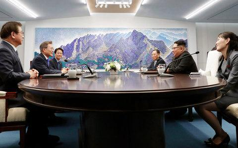 <span>North Korean leader Kim Jong-un, second from right, talks with South Korean President Moon Jae-in</span> <span>Credit: AP </span>