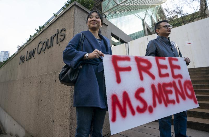 Supporters protest outside the bail hearing for Huawei CFO Meng Wanzhou, who was arrested in December as she changed planes in Vancouver (AFP Photo/Rich Lam)