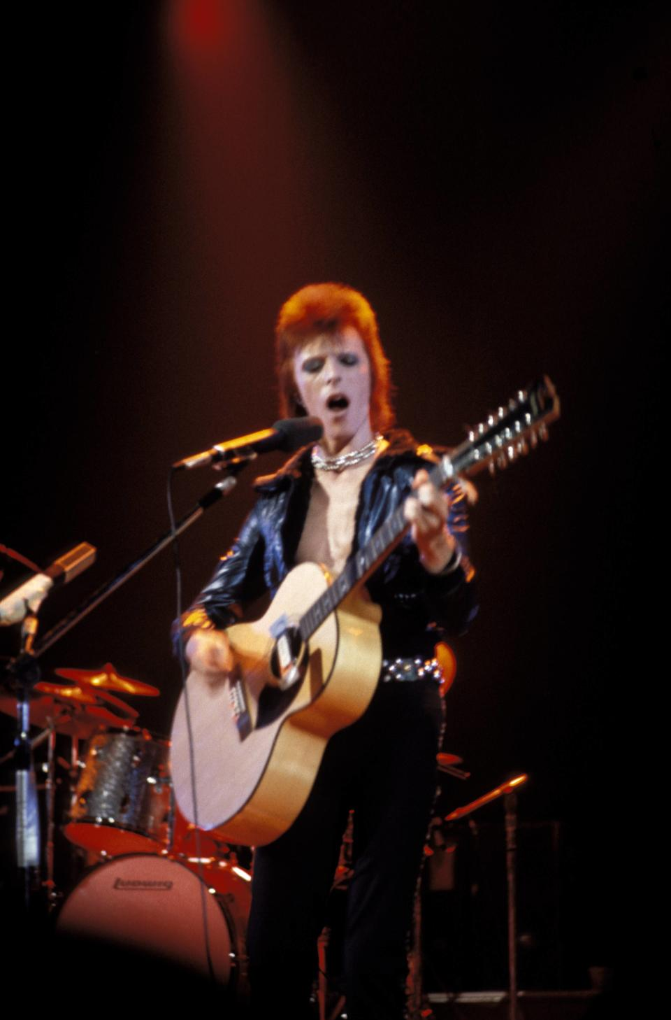 UNITED STATES - SEPTEMBER 22:  Photo of David BOWIE; performing live onstage on first date of Ziggy Stardust US Tour at the Music Hall, Cleveland, playing 12 string acoustic guitar  (Photo by John Lynn Kirk/Redferns)