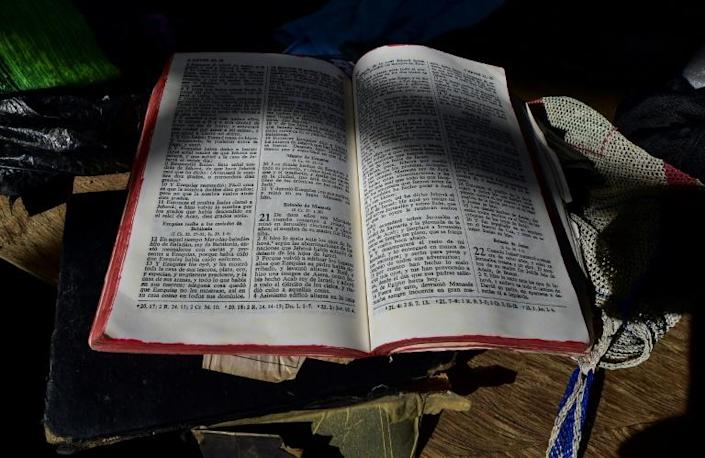 A bible and messages alluding to the devil can still be seen in the church where exorcism was carried out (AFP Photo/Luis ACOSTA)