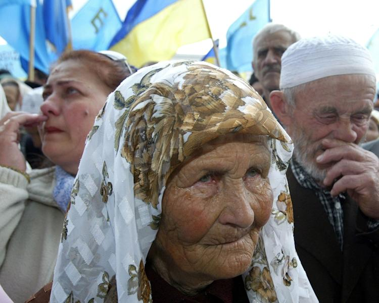 Ukraine is calling on the International Court of Justice to urge Russia to halt racial discrimination in the Crimea, particularly against the Tatars (AFP Photo/SERGEY SUPINSKI)