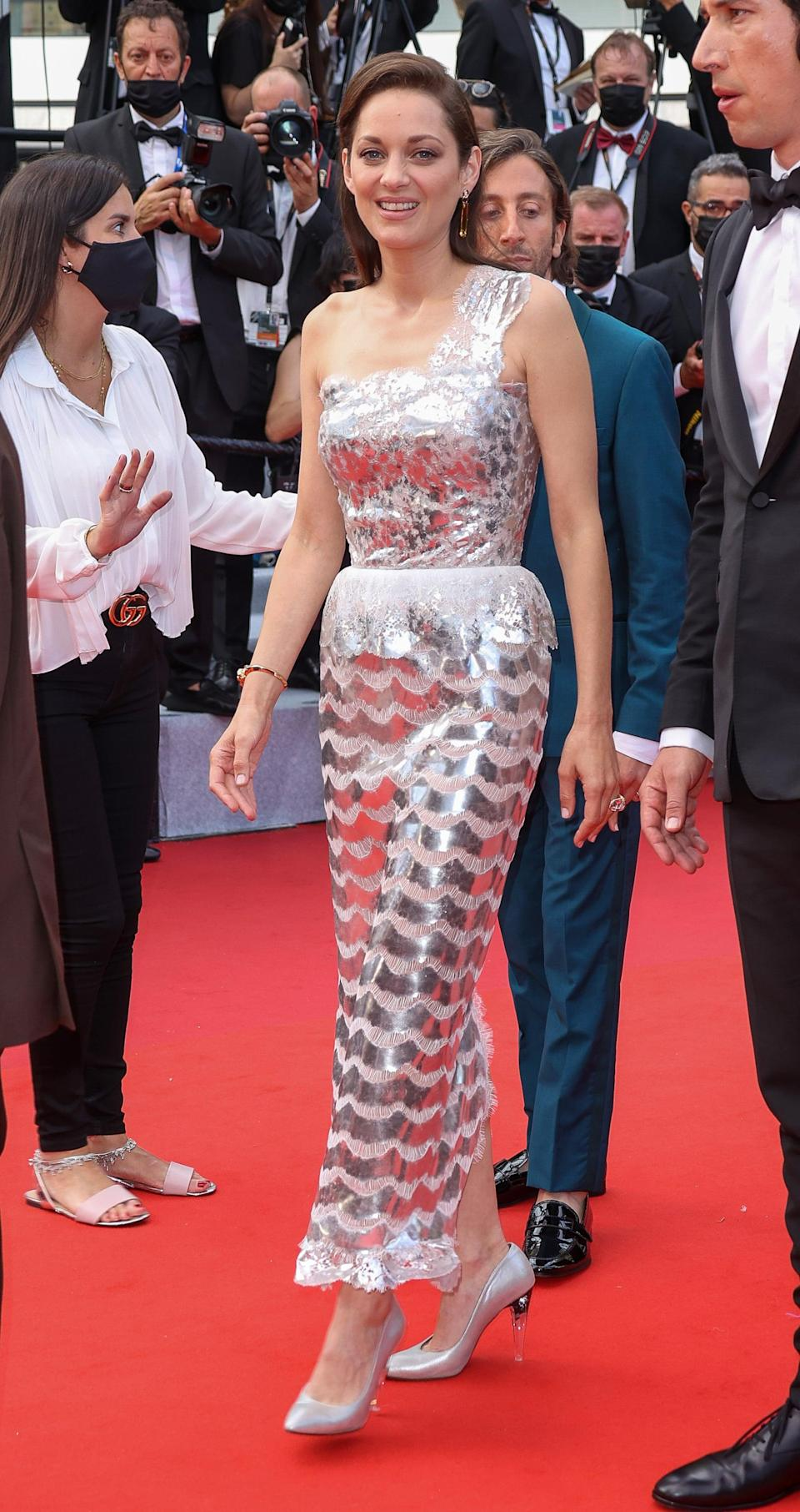 <p>Wearing a Chanel Haute Couture look.</p>
