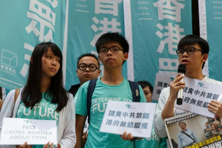Joshua Wong (C) and other pro-democracy activists in Hong Kong gathered on June 17, 2016, after the revelations from a city bookseller about his detention in China