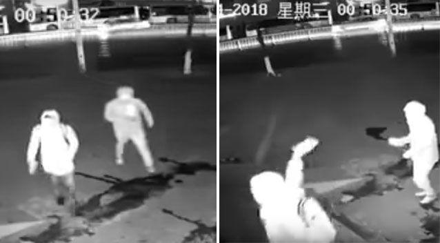 The thieves can be seen arriving before one throws a brick through the store's window. Source: Weibo/ Shanghai Municipal Police