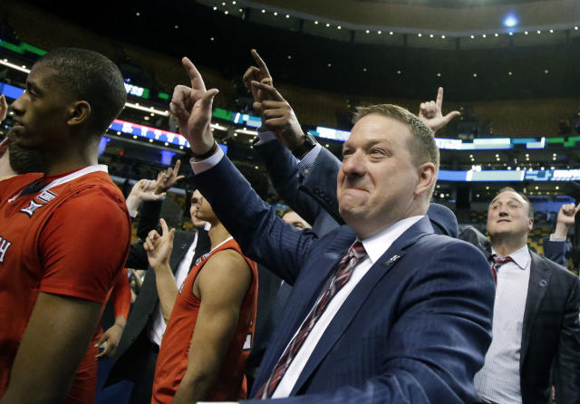 Texas Tech coach Chris Beard celebrates with his team after a 78-65 win over Purdue in an NCAA men's college basketball tournament regional semifinal early Saturday, March 24, 2018, in Boston. (AP Photo/Mary Schwalm)