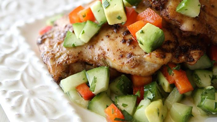 """Homemade salsa usually relies on superfresh tomatoes, yet here's a version that calls for other vegetables, which (yay!) you can find year-round: cucumber, red bell pepper and avocado. Mix them with lime juice, cilantro and honey, and you've got a quick and tasty topper for cumin-and-lime-coated chicken thighs that cook under the broiler in a matter of minutes. <br><br> <strong>Get the recipe: <a href=""""http://www.oprah.com/food/Spicy-Chicken-Thighs-with-Cucumber-Avocado-Salsa-Recipe"""" rel=""""nofollow noopener"""" target=""""_blank"""" data-ylk=""""slk:Spicy Chicken Thighs with Cucumber-Avocado Salsa"""" class=""""link rapid-noclick-resp"""">Spicy Chicken Thighs with Cucumber-Avocado Salsa</a></strong>"""