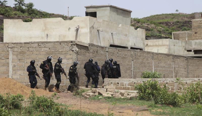 Malian Police officers take position outside Campement Kangaba, a tourist resort near Bamako, Mali, Monday, June. 19, 2017. Authorities in Mali say the death toll has risen following a terror attack on a luxury resort area popular with foreigners in Mali's capital. (AP Photo/Baba Ahmed)