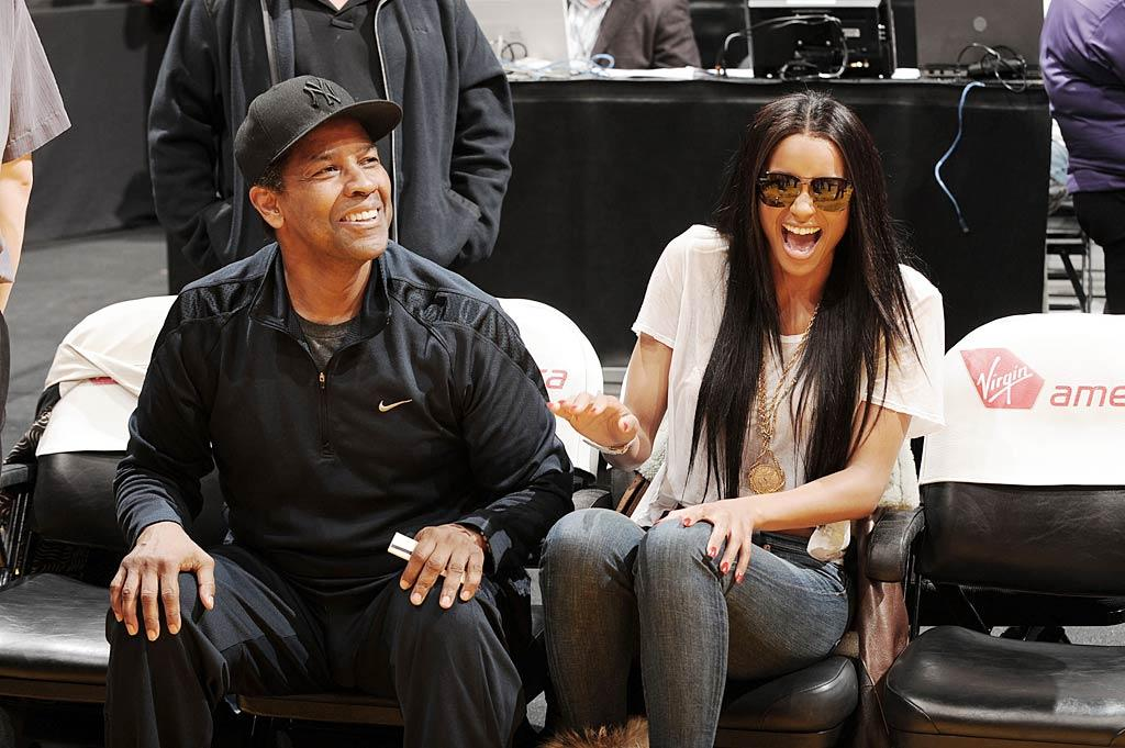 """Later, the Oscar winner was spotted flirting with """"Goodies"""" songstress Ciara. Who knew Denzel was so hilarious? Andrew D. Bernstein/NBAE/<a href=""""http://www.gettyimages.com/"""" target=""""new"""">GettyImages.com</a> - January 9, 2011"""