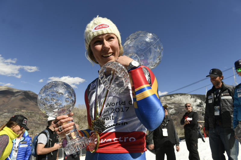 Mikaela Shiffrin holds the crystal globe trophy for the overall World Cup, right, and the smaller crystal globe for the World Cup slalom title, left, at the bottom of Aspen Mountain after the 2017 Audi FIS Ski World Cup Finals at Aspen Mountain on March 19, 2017 in Aspen, Colorado. (Photo by Helen H. Richardson/The Denver Post via Getty Images)
