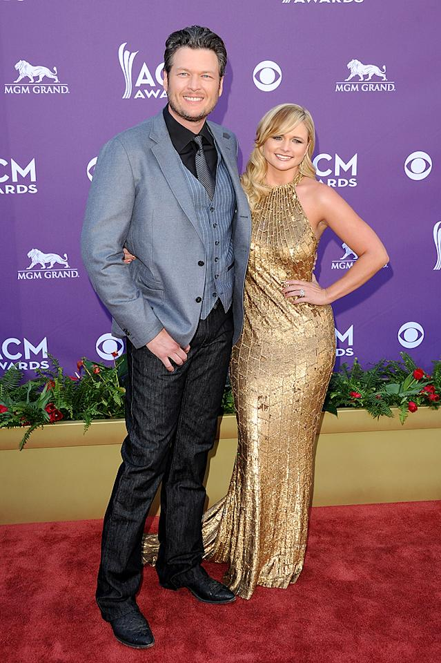 "One of the evening's co-hosts, ""The Voice"" coach Blake Shelton, looked dapper in gray and black when he arrived with his wife, fellow country musician Miranda Lambert, who donned a dress that reminded us of Stacy Keibler's Oscars gown. Do you like Miranda's look?"