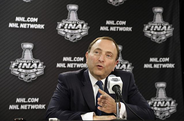FILE - In this June 12, 2013, file photo, NHL Commissioner Gary Bettman speaks during an NHL hockey news conference in Chicago. NHL Commissioner Gary Bettman declined to comment on the impact of the NFL football concussions lawsuit last month, but he said the league has been proactive for decades in addressing head injuries. (AP Photo/Nam Y. Huh, File)