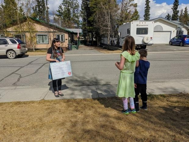 Whitehorse teacher Monique Levesque visited some of her students last spring at their homes, when schools were closed due to the pandemic. CBC reporter Steve Silva's story about Levesque's 'driveway visits' won an RTDNA award for feature news coverage. (Steve Silva/CBC - image credit)
