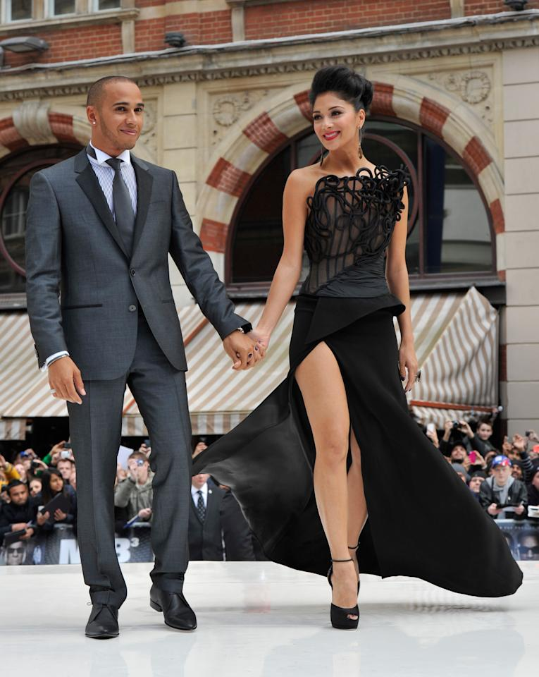 LONDON, ENGLAND - MAY 16:  (EMBARGOED FOR PUBLICATION IN UK TABLOID NEWSPAPERS UNTIL 48 HOURS AFTER CREATE DATE AND TIME. MANDATORY CREDIT PHOTO BY DAVE M. BENETT/GETTY IMAGES REQUIRED)  Lewis Hamilton and Nicole Scherzinger (R) attend the UK premiere of 'Men in Black 3' at Odeon Leicester Square on May 16, 2012 in London, England. (Photo by Dave M. Benett/Getty Images)