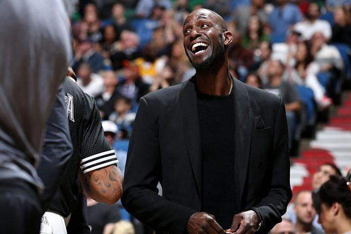 This is the only time Kevin Garnett ever enjoyed sitting on an NBA bench. (Getty Images)