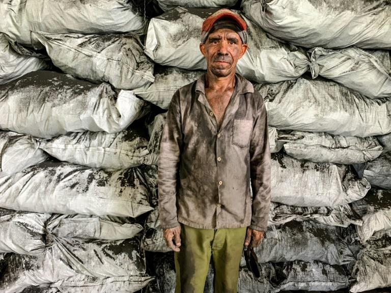Eddy Peregrino, 52, is one of few dozen men taking part in a government-sponsored job-creation program to bring back traditional charcoal-making to an area where it used to be a way of life
