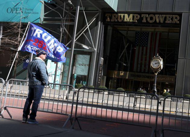 Former President Donald Trump's supporter stands in front of Trump Tower in New York on March 7, 2021. (Photo: Caitlin Ochs via Reuters)