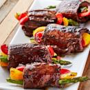 """<p>Balsamic glazed steaks get rolled around fresh veggies for the perfect combo. It's a fun appetiser or an easy summer dinner. Securing the roll-ups with toothpicks makes them MUCH easier to cook. Just don't forget to remove them when it's time for serving!</p><p>Get the <a href=""""https://www.delish.com/uk/cooking/recipes/a35261967/balsamic-steak-roll-ups-recipe/"""" rel=""""nofollow noopener"""" target=""""_blank"""" data-ylk=""""slk:Balsamic Steak Rolls-Ups"""" class=""""link rapid-noclick-resp"""">Balsamic Steak Rolls-Ups</a> recipe.</p>"""
