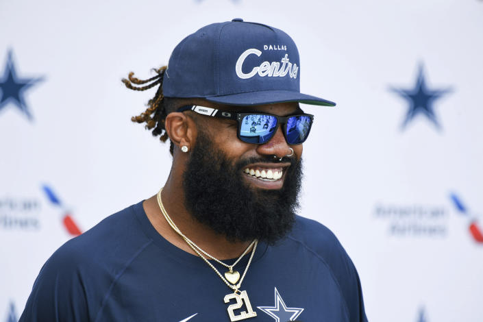 Dallas Cowboys running back Ezekiel Elliott answers questions from reporters following practice at the NFL football team's training camp in Oxnard, Calif., Thursday, July 22, 2021. (AP Photo/Michael Owen Baker)