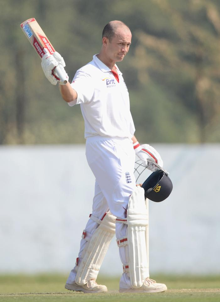 AHMEDABAD, INDIA - NOVEMBER 11:  Jonathan Trott of England raise his bat after reaching his century during day four of the tour match between England and Haryana at Sardar Patel Stadium ground B on November 11, 2012 in Ahmedabad, India.  (Photo by Gareth Copley/Getty Images)
