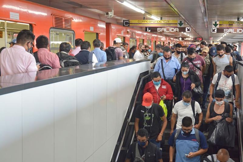 Commuters crowd together at Pantitlan station last week as restrictions across Mexico eased despite rising cases and deaths.