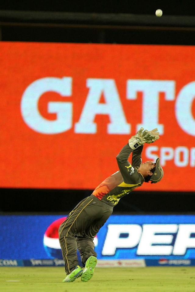 Quinto De Kock takes a catch to dismiss Mandeep Singh during match 25 of the Pepsi Indian Premier League between The Sunrisers Hyderabad and The Kings XI Punjab held at the Rajiv Gandhi International  Stadium, Hyderabad  on the 19th April 2013Photo by Prashant Bhoot-IPL-SPORTZPICS Use of this image is subject to the terms and conditions as outlined by the BCCI. These terms can be found by following this link:https://ec.yimg.com/ec?url=http%3a%2f%2fwww.sportzpics.co.za%2fimage%2fI0000SoRagM2cIEc&t=1503264028&sig=DZ9Qr1KHpZgiYn5m.80Nqg--~D