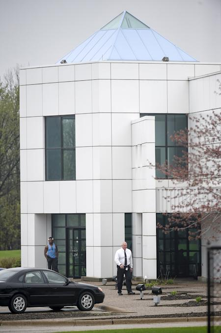 A law enforcement officer and an employee are seen outside of Paisley Park, music superstar Prince's estate in Chanhassen, Minnesota. (Reuters/Craig Lassig)