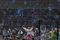 Helio Castroneves and Spain's Alex Palou traded the lead several times in the Indianapolis 500
